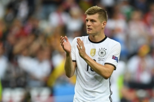 Germany's midfielder Toni Kroos greets the crowd followint the Euro 2016 group C football match between Germany and Poland at the Stade de France stadium in Saint-Denis near Paris on June 16, 2016. / AFP / PATRIK STOLLARZ        (Photo credit should read PATRIK STOLLARZ/AFP/Getty Images)